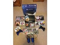 PS3 Slim 500gb 3 controllers 15 games & headset