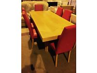 large dining table and six quality red leather chairs