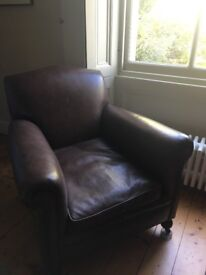 Vintage leather armchair with fireside castors.
