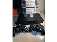 PS2 Bundle - 2 Controllers, 2 Memory Cards, 29 games