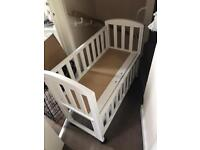 Jack and Lilly next too me crib for sale..