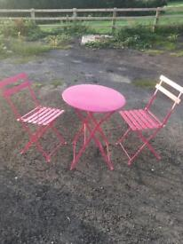 Small pink outdoor table and chairs