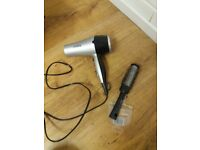 Hairdryer and brush. Good condition