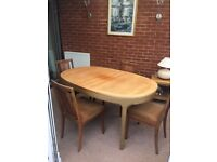 Solid extending oval,teak Nathan table & 4 G Plan chairs