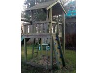Good condition outdoor play house and swing