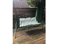 Green metal garden swing