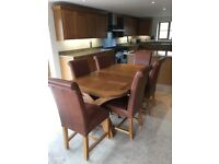 Very solid dining table and six chairs