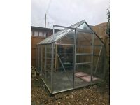Large Greenhouse includes shelving and pots