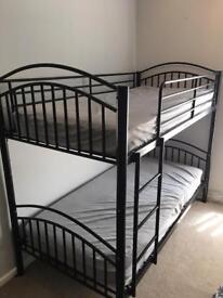 Black metal bunkbed and mattresses