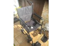 Brand new ( used once) collaposable portable wheelchair