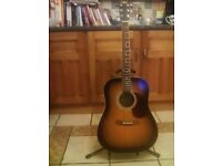 Hohner acoustic guitar.