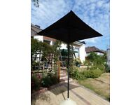 Two Garden Parasols + one base.