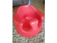 Bumbo with tray (child seat in red)