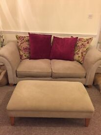 Cream sofa with foot stall