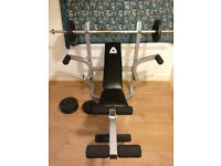 Workout bench with bar and weights