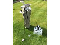 New, unused, ladies' golf set. John Letters Trilogy. Still wrapped, never used.