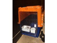 Extra large dog crate suitable for international travel. Excellent condition.