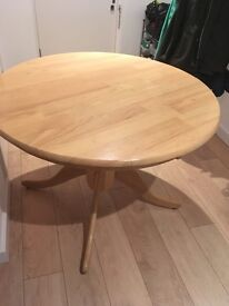 Solid Round Pine Dining Table. Can deliver