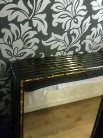 Black gold mirrors
