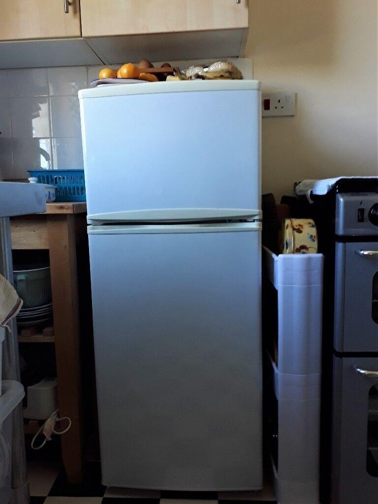 Fridge Freezer. Standard fridge - medium size freezer. Good for a ...