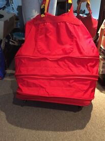 Expandable red luggage bag