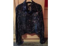 Versace Couture Denim Jacket( not Chanel or Louis Vuitton) a very similar one on asos right now