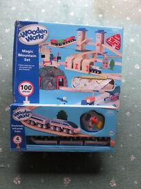 Early Learning Centre Wooden Rail and Road Set with separate battery operated train.