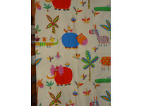 2 matching children's single quilt covers and matching curtain