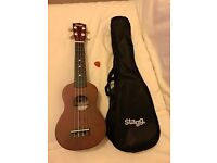 Stagg ukulele with pick and case.