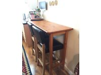 Solid oak bar stools and pine table set