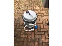 Aquaroll with pump, hosepipe and handle