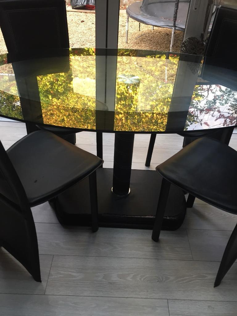 Oval glass top table & 4 chairs - bargain £25.00