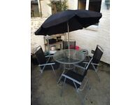 Garden table, 4 chairs and umbrella