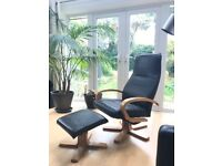 Reclining, swivel armchair in black leather, with matching stool