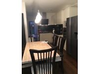 Harveys Marble Dining Table with six chairs
