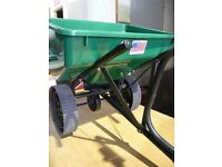 Tow behind seed/fertiliser spreader for ride on mower