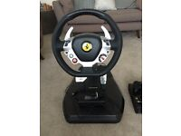 Xbox 360 with Ferrari steering wheel.
