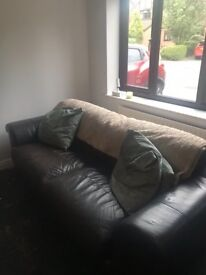 Dark brown leather three seater sofa and chair
