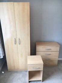 Three piece bedroom furniture set. Wardrobe, chest of drawers and bedside table.