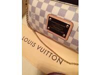 100% authentic Louis Vuitton Damier Azure Eva Clutch with receipt, excellent condition.