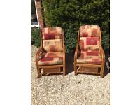 Two comfy conservatory arm chairs.