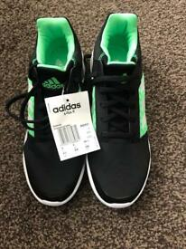 Black /green adidas trainers