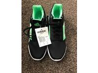Black /green adidas trainers