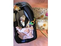 (REDUCED) Reborn doll, car seat and a big bundle of clothes.