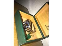 Rolex Submariner blue face 2004 edition. Full box & papers