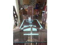 Glass dining table and six chairs Excellent condition