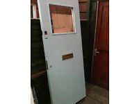 Exterior fire door with glass panel