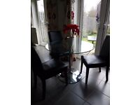 Glass table with 3 faux leather chairs