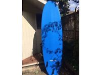 TRIBORD 100 FOAM SURFBOARD 7'. SUPPLIED WITH LEASH AND FINS. EXCELLENT CONDITION