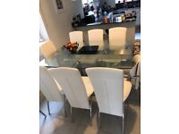 Dwell extending dining table and 8 cream chairs